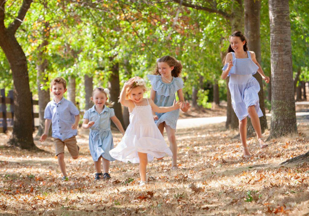 Kids Running in Autumn Leaves