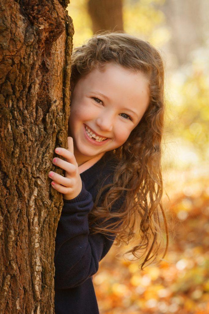 Girl behind a Tree in Gisborne